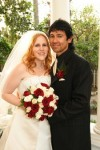 Bride & Groom with red-wood and ivory rose wedding bouquet
