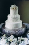 White Wedding Cake Topped With Beautiful Flowers