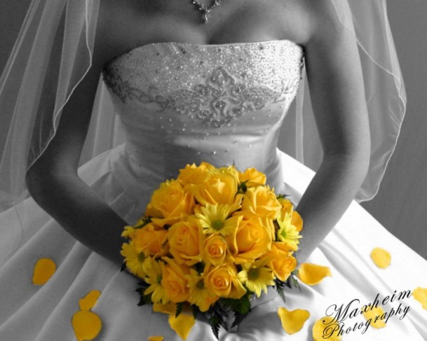 This golden yellow bridal bouquet pops in this otherwise black and white