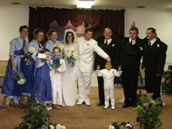 The groom and ring bearer wore all white tuxedos It was like mini me