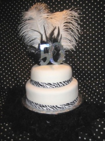 of the party which was black and white. What a cool 50th birthday cake!