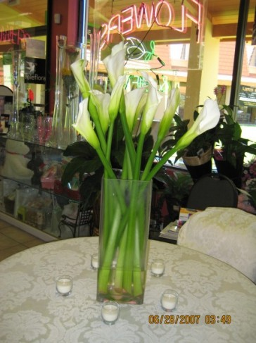 Wedding reception flowers often feature calla lily centerpieces as the
