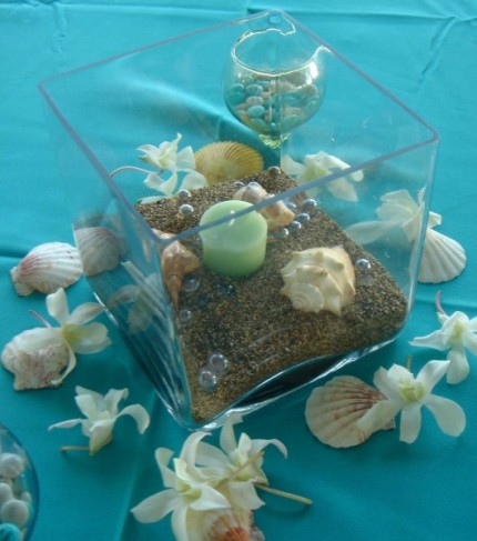 This beach themed centerpiece is a unique addition to any beach wedding