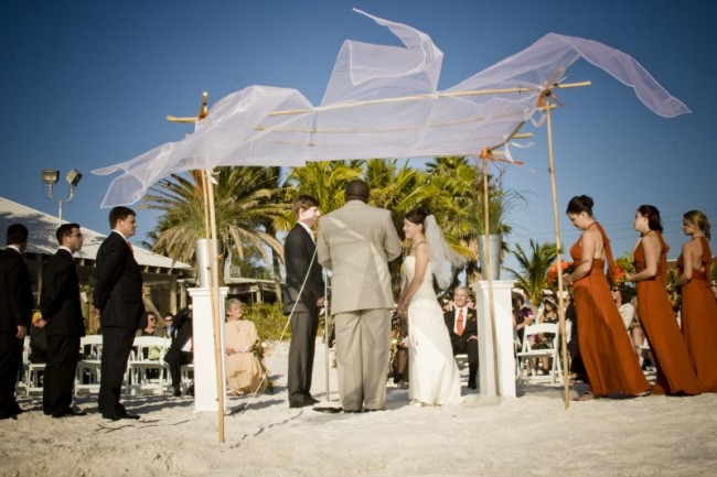 Beach weddings are very popular Light wedding canopies like this fit the