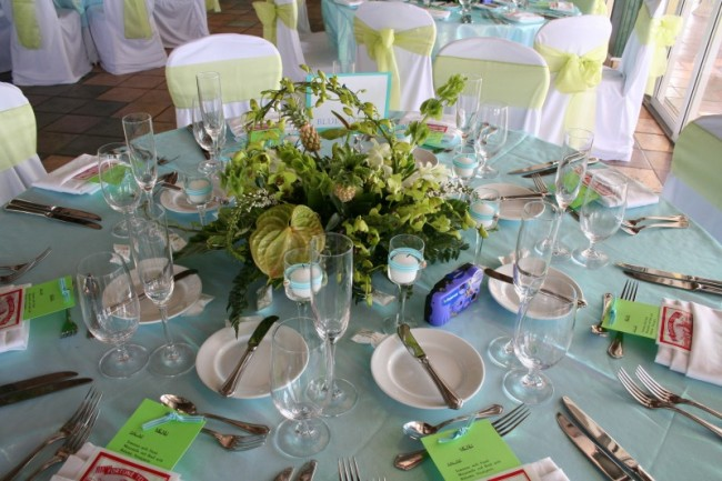 This wedding reception is decorated in light green and white with a pastel