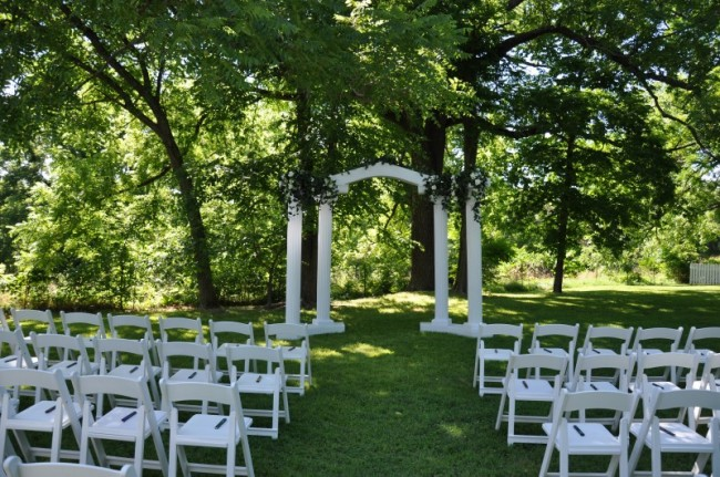 Simple Outdoor Ceremony Decorations: Plain White Wedding Arch And Chairs
