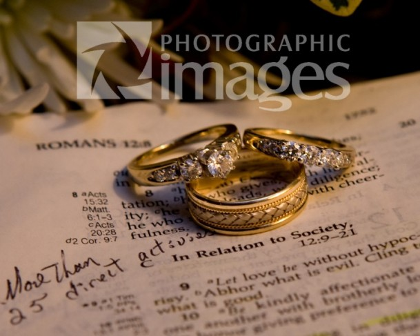 Here the wedding rings and engagement ring are placed on the Holy Bible