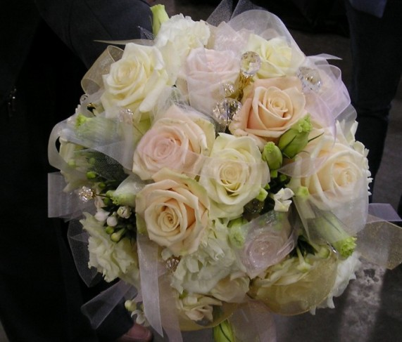 This elegant bridal bouquet is filled with sparkling jewels and a mix of