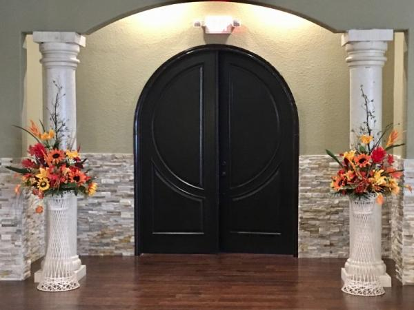 Large Flower Arrangements at Wedding Entrance