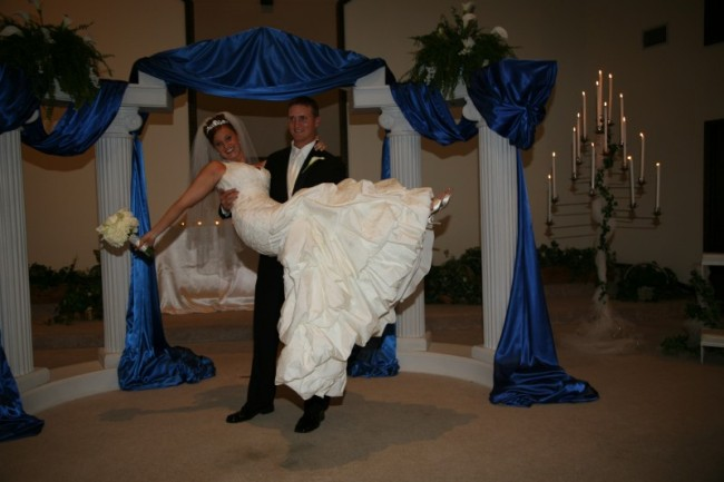 Photo Gallery - Photo of Groom Holding Bride In Air