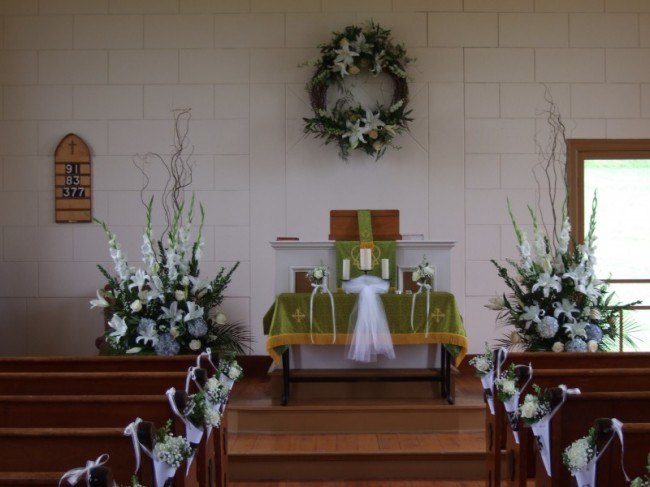 Country Church Wedding Flowers Share Classy urn arrangements and grapevine