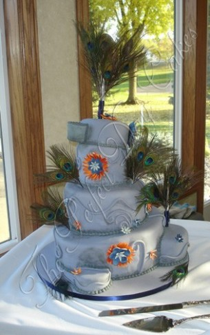 Naomi chose a slate gray blue wedding cake for her wedding reception