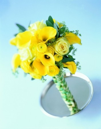 Handtied wedding bouquet with yellow roses tucked in and around yellow