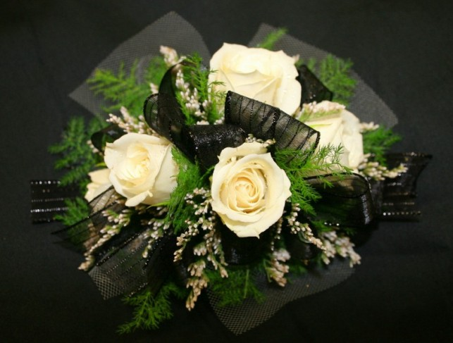 This unique white rose wedding bouquet was created using sheer black ribbon