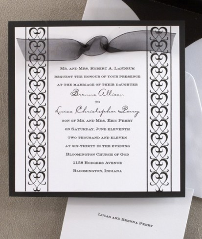 This formal wedding invitation is a matte black card layered with a slightly