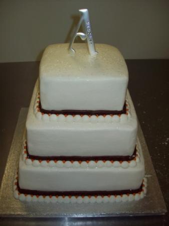 [Traditional Wedding Cake With Monogram Topper]