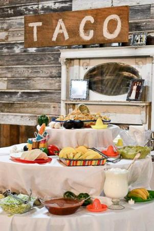 wedding-taco-bar-decorated-with-mexican-hats-and-wooden-plaque-white-acresfarms-334x500.jpg