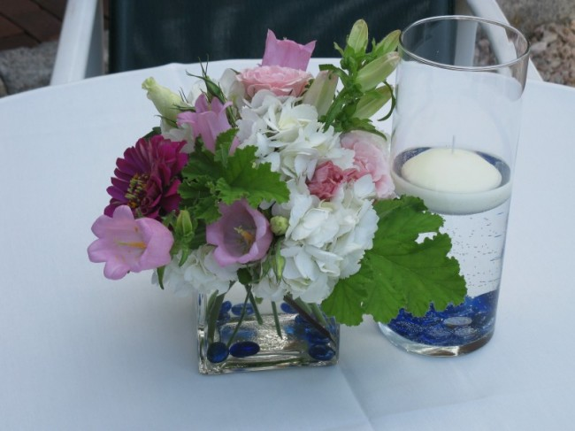Photo gallery cocktail table centerpieces blue floral for Patio table centerpiece