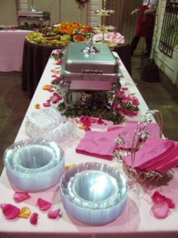 This romantic pink themed wedding reception table is accented with pink rose
