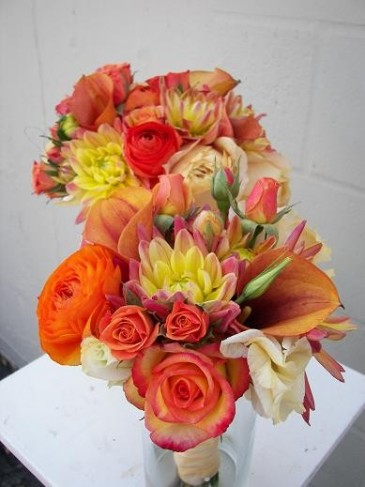 With shades of orange and yellow these wedding flowers would make the
