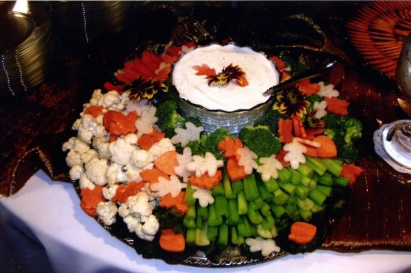Vegetables and vegetable dip form a colorful fall food centerpiece for this