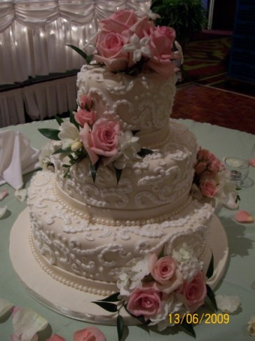 Elegant Wedding Cake With Flower Accents