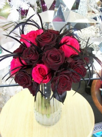 Fuchsia Black Bacarra Roses and Feathers This unique floral centerpiece is