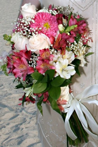 Gourgeous Summery wedding bouquet featured in pretty pink and ivory flowers