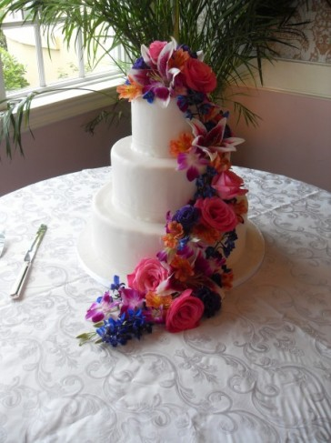 White Wedding Cake With Tropical Arrangement