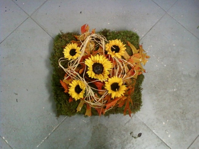 This bright flower arrangement would make the perfect centerpiece at a fall