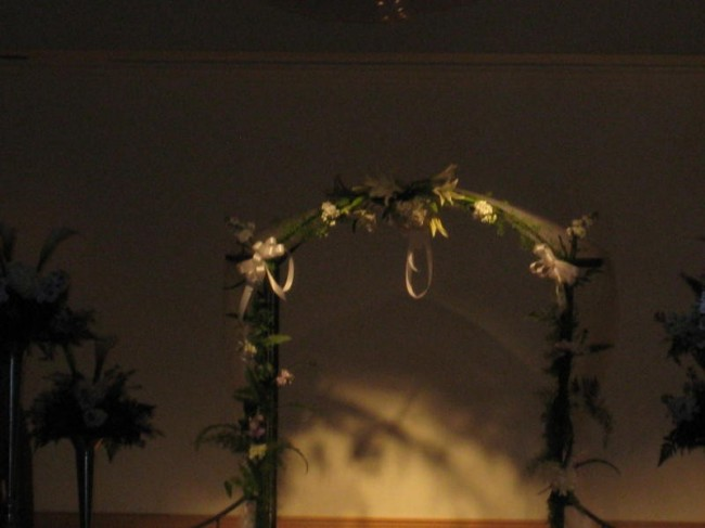 Go for something a little more classy with a simple flower wedding arch