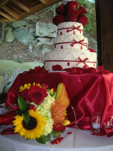 Red Wedding Cake and Bridal Bouquet
