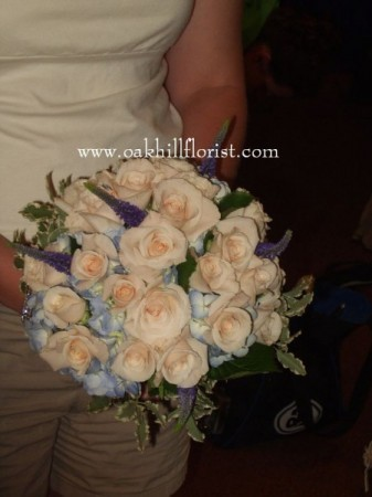 These wedding flowers are beautiful for a soft blue and peach wedding theme
