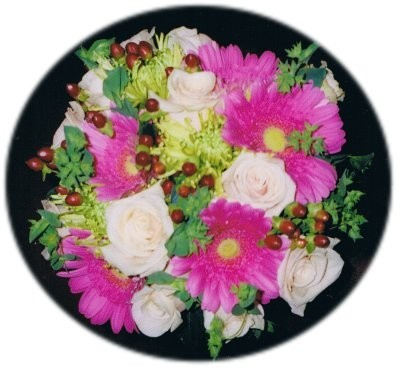 This bright flower arrangement has been made from hot pink daisies and white