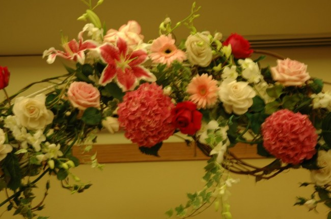 The flowers for this wedding arch are a beautiful combination of pink and