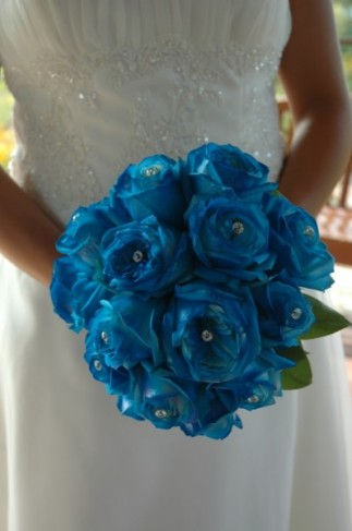 This gorgeous blue bridal bouquet was created with blue roses