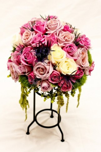 This beautiful rose centerpiece features beautiful pink lavender and cream
