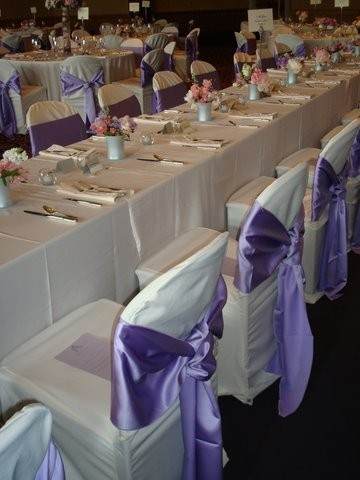 This beautiful wedding reception features tables that are adorned with