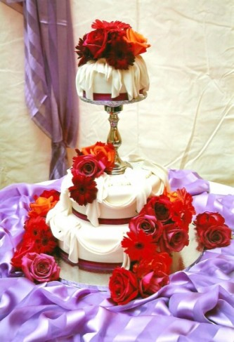 3 Tiered Wedding Cake With Colorful Flowers