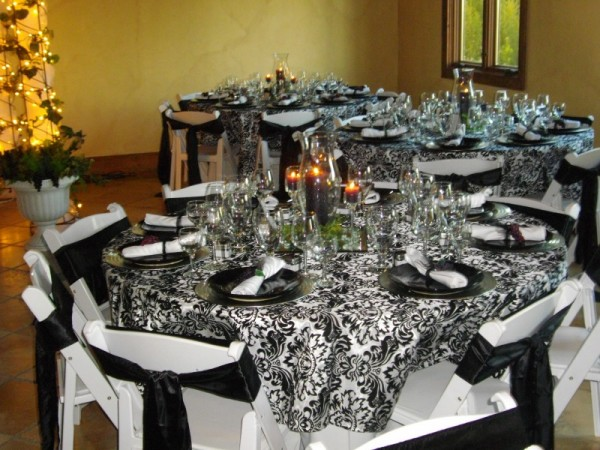 This gorgeous wedding reception has beautiful black and white damask print