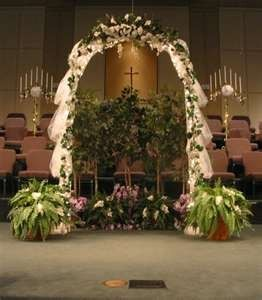 Arch with tulle and green plants