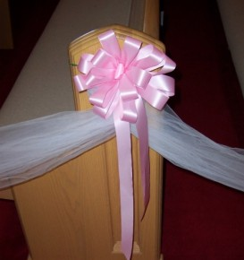Pink Bow on Wedding Pew
