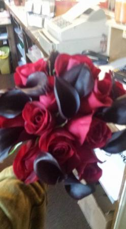red roses with black accents