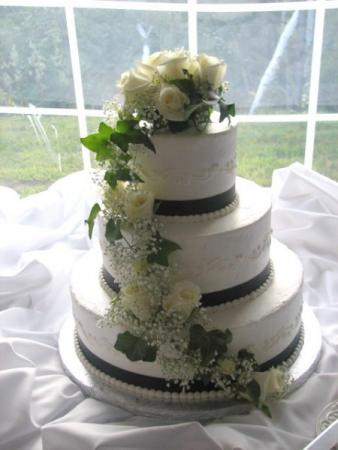 White wedding cake with floral topper