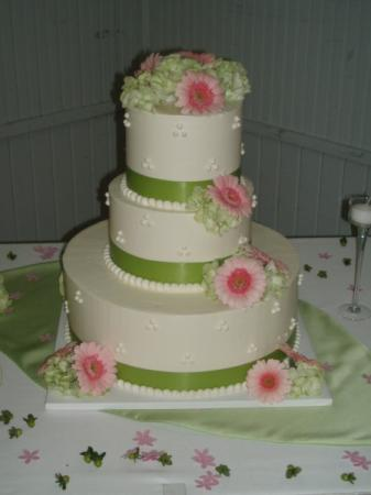 White Wedding Cake Accented With Pink & Green Flowers